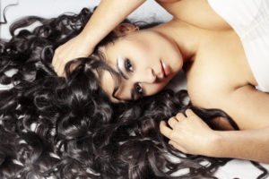 Attractive woman with long hair extensions.