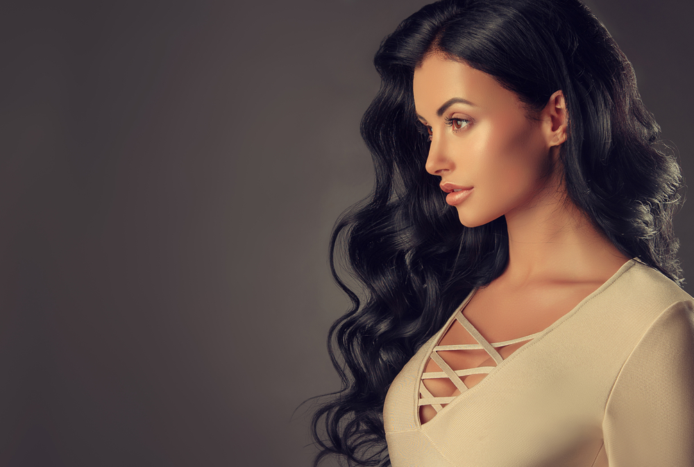 Woman wearing habit hand tied hair extensions.