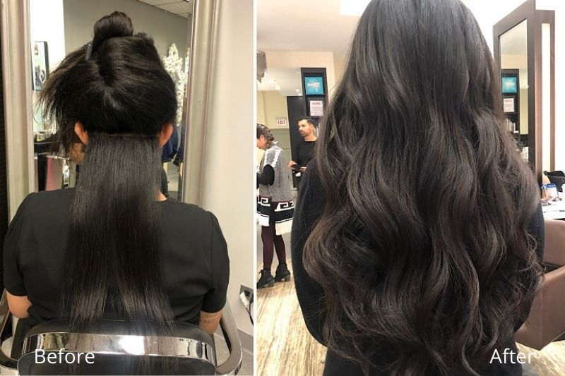Girl with hand Tied Extensions at Chicago Hair Extensions Salon